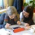 Volunteers at a digital inclusion workshop
