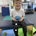 Picture of Young Child holding  LusioMATE pack and Sensors on
