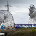 Train  on its way to Bo-Ness, travelling past The Kelpies at Grangemouth, Forth & Clyde Canal
