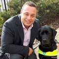 Close up of Dan Williams and his Guide Dog Zodiac