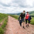 People hiking in The Brecon Beacons