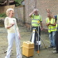 Charlotte on-site of current project with workmen