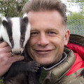 Chris Packham with a badger