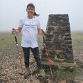 Lynette Lewis on the summit of Ingleborough fundraising for the British Tinnitus Association by completing the Yorkshire Three Peaks Challenge