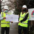 Peter Forster and Rachel Astill accepting a cheque for £13,000 from Barratt Homes