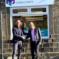 Scott Mourton, MD of Milestone Insurance (left) shakes hands with Bill Holmes, CEO of Radius Payment Solutions