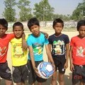 Street children getting ready to play football