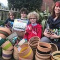 Suzanne and her children with crafts from Kasigau.