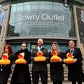 Staff from Lowry Outlet announce the sponsorship of the 2019 Quays Duck Race