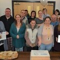 Coastline staff and volunteers come together to celebrate the Investing in Volunteers reaccreditation.