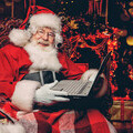 Santa gets ready to video call children across the UK - but more help is needed to meet demand