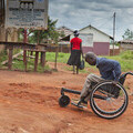 Benson tackling uneven ground in his Rough Terrain wheelchair in Uganda