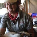 Photo of Tammy Hoth-Hanssen with anaesthetised lion as part of a research project in Northern Namibia