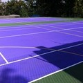 Tennis court maintenance and renovation project with coloured anti slip paint and multi use line markings to a facility in London.