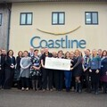 Colleagues from Coastline Housing in Redruth gather to present their cheque for over £6000 to Ella's Memory.