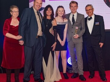 The Taylor Family of Kent accept their 2017 Soldiering On Award from actress Vicky Michelle (center) and Deputy Chairman Robin Cordell (right).