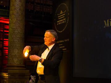 Michael King performing magic tricks on stage - Prestigious Star Awards 2018