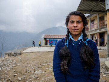 Monica, 14, walks 25 minutes to and from her school in the Sindhupalchowk district each day. She plays football as part of our