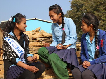 Students sharing a story at the opening celebration of their new classrooms in the Sindhupalchowk district. PHOTO CREDIT: Childreach Nepal
