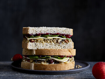 Brie, Cranberry and Stuffing on Onion Seed Bloomer