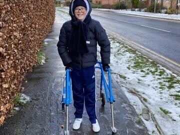 Thomas smiling during his mile walk