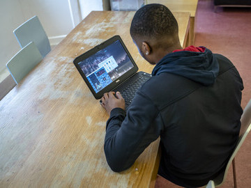 Homeless youth using laptops