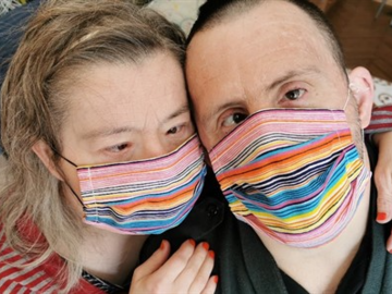 Image of 2 people in Masks with Down syndrome