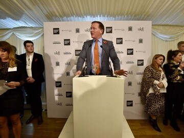 Damian Collins MP addressing guests at the Houses of Parliament