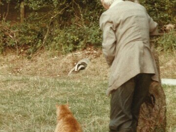 Eric Ashby and friend watch a badger emerge