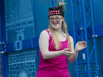DanceSyndrome Dance Leader and Ambassador Becky Rich entertains the crowds on the Royal Mile stage.