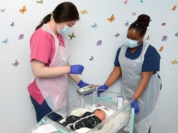 Midwives performing the pulse oximetry test at Royal Berks Hospital