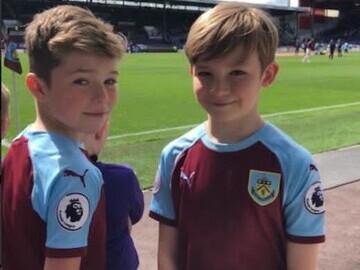 Hughie Higginson and Freddie Xavi in their Burnley shirts