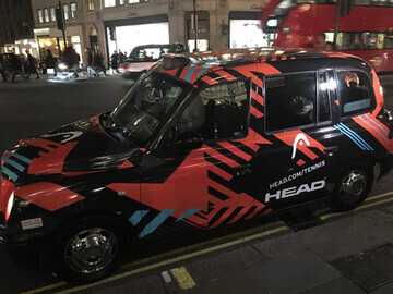 The Head Tennis taxi at night