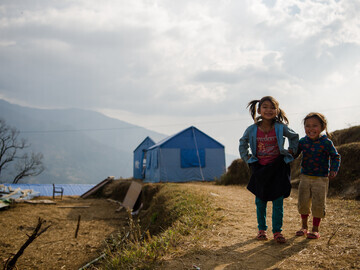Young children giggle just feet away from their new classrooms. PHOTO CREDIT: Jen Ciochon and Al Jazeera